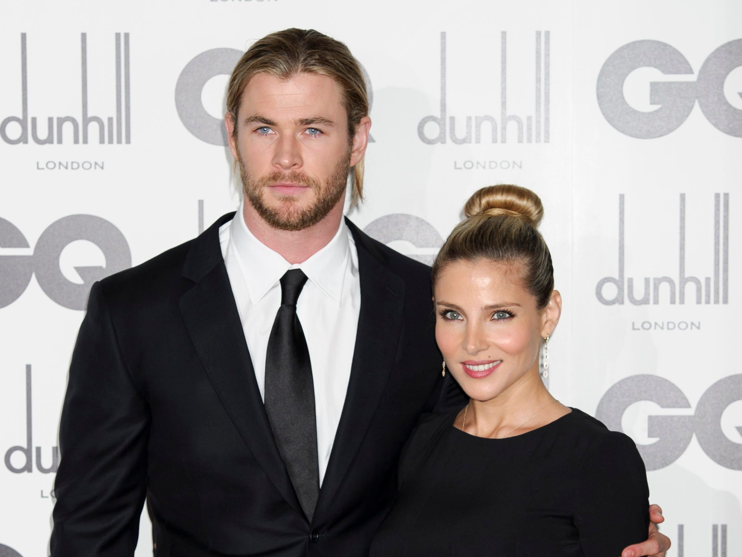 Elsa Pataky and Chris Hemsworth arrive for the GQ Men of the Year Awards at a central London venue, Tuesday, Sept. 4, 2012. (AP Photo/Jonathan Short)