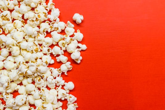 Tasty Salted Popcorn Isolated On Red Background