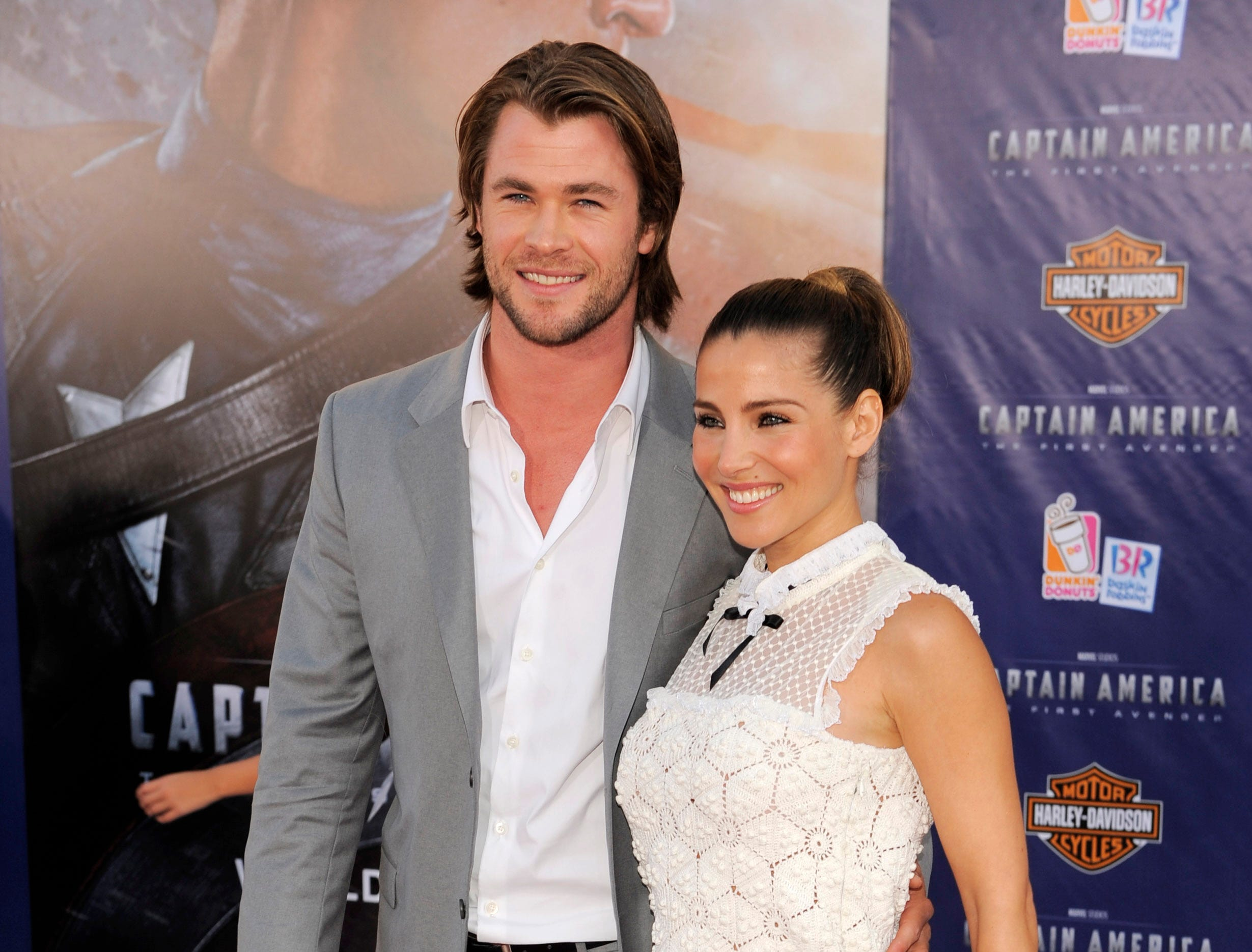 "ORG XMIT: CACP101 Actor Chris Hemsworth and his wife, actress Elsa Pataky, pose together at the premiere of the film ""Captain America: The First Avenger,"" in Los Angeles, Tuesday, July 19, 2011. The film is to be released on Friday, July 22. (AP Photo/Chris Pizzello)"