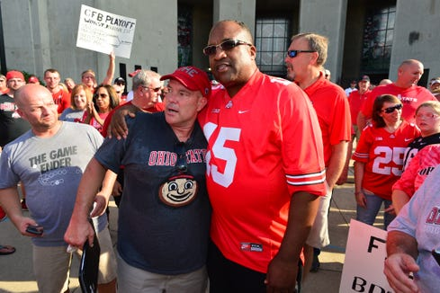 COLUMBUS, OH - AUGUST 6:  Jeff Hamms, organizer of a rally in support of Ohio State head football coach Urban Meyer, and Stacy Elliott, father of former Ohio State running back Ezekiel Elliott, embrace at Ohio State University on August 6, 2018 in Columbus, Ohio. Meyer is on paid administrative leave after a reports alleging he knew of a 2015 allegation of domestic violence against former assistant football coach Zach Smith, who was fired in July.  (Photo by Jamie Sabau/Getty Images) ORG XMIT: 775205352 ORIG FILE ID: 1012240762
