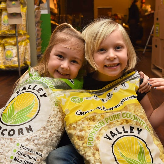 Two happy customers enjoying Valley Popcorn