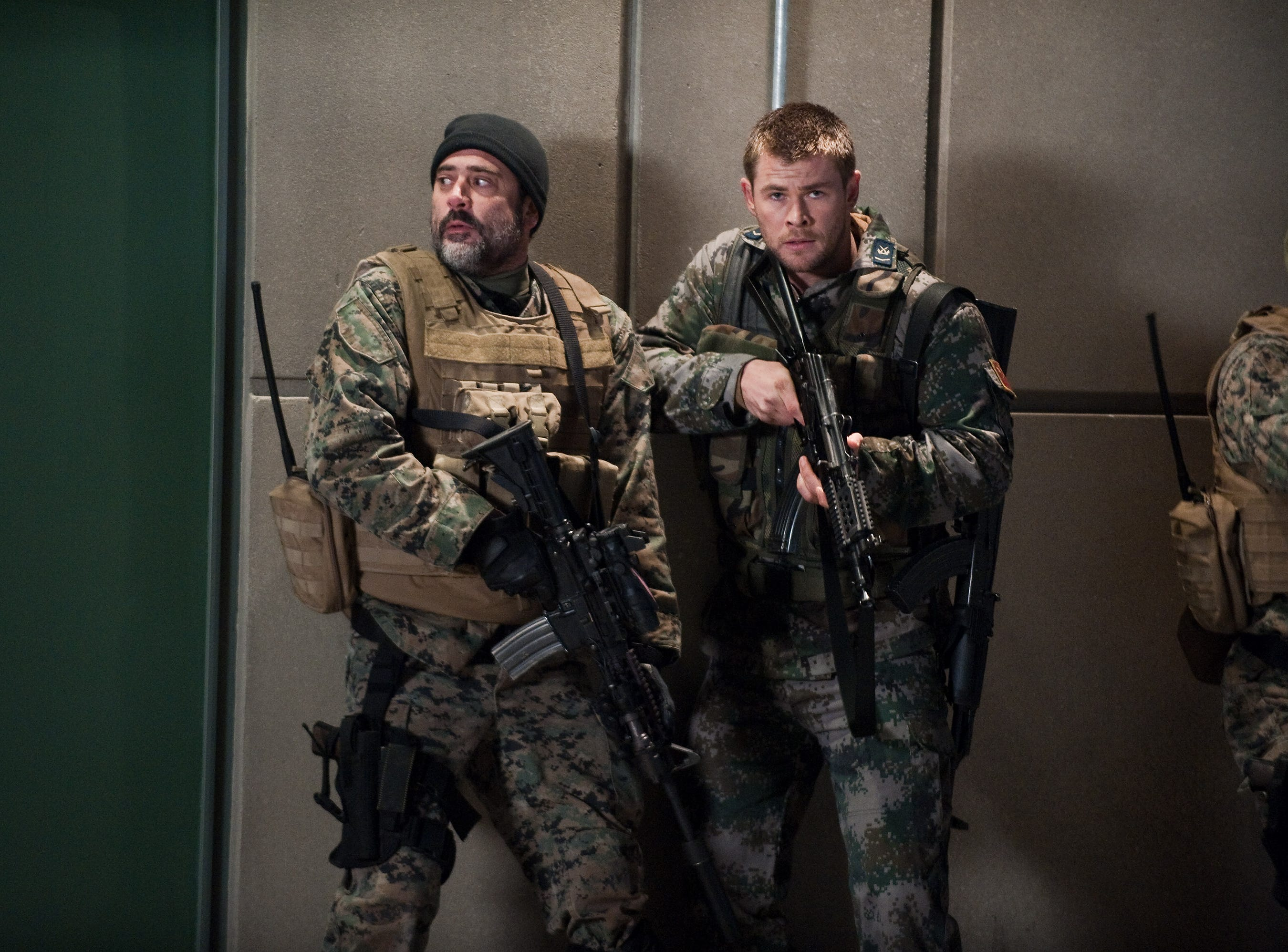 "Jeffrey Dean Morgan and Chris Hemsworth in a scene from the motion picture ""Red Dawn."" Photo by Ron Phillips, Metro-Goldwyn-Mayer Studios [Via MerlinFTP Drop]"