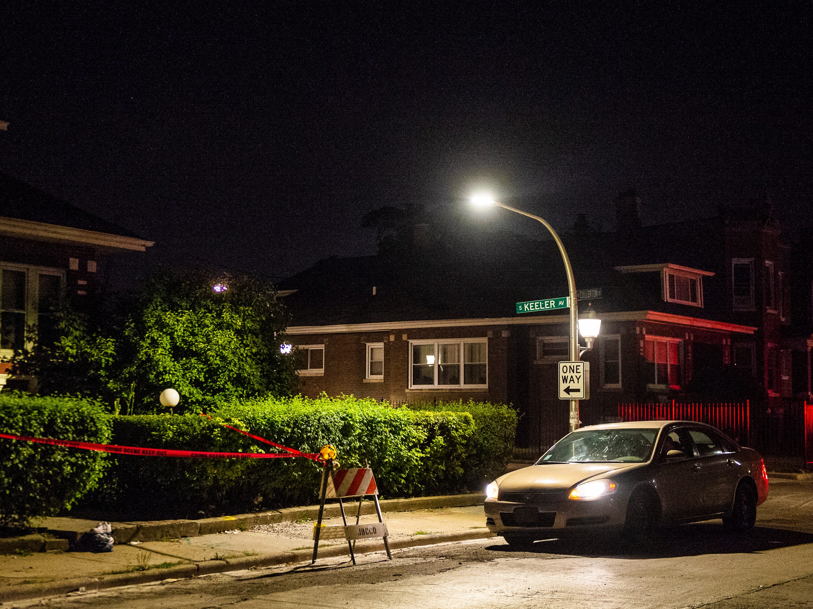 In this Aug. 5, 2018 photo, police tape surrounds the scene where a man was shot in Chicago.