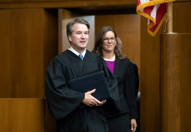 President Donald Trump's Supreme Court nominee, Judge Brett Kavanaugh, officiated in Washington Tuesday at the swearing-in of Judge Britt Grant, right, to take a seat on the U.S. Court of Appeals for the Eleventh Circuit