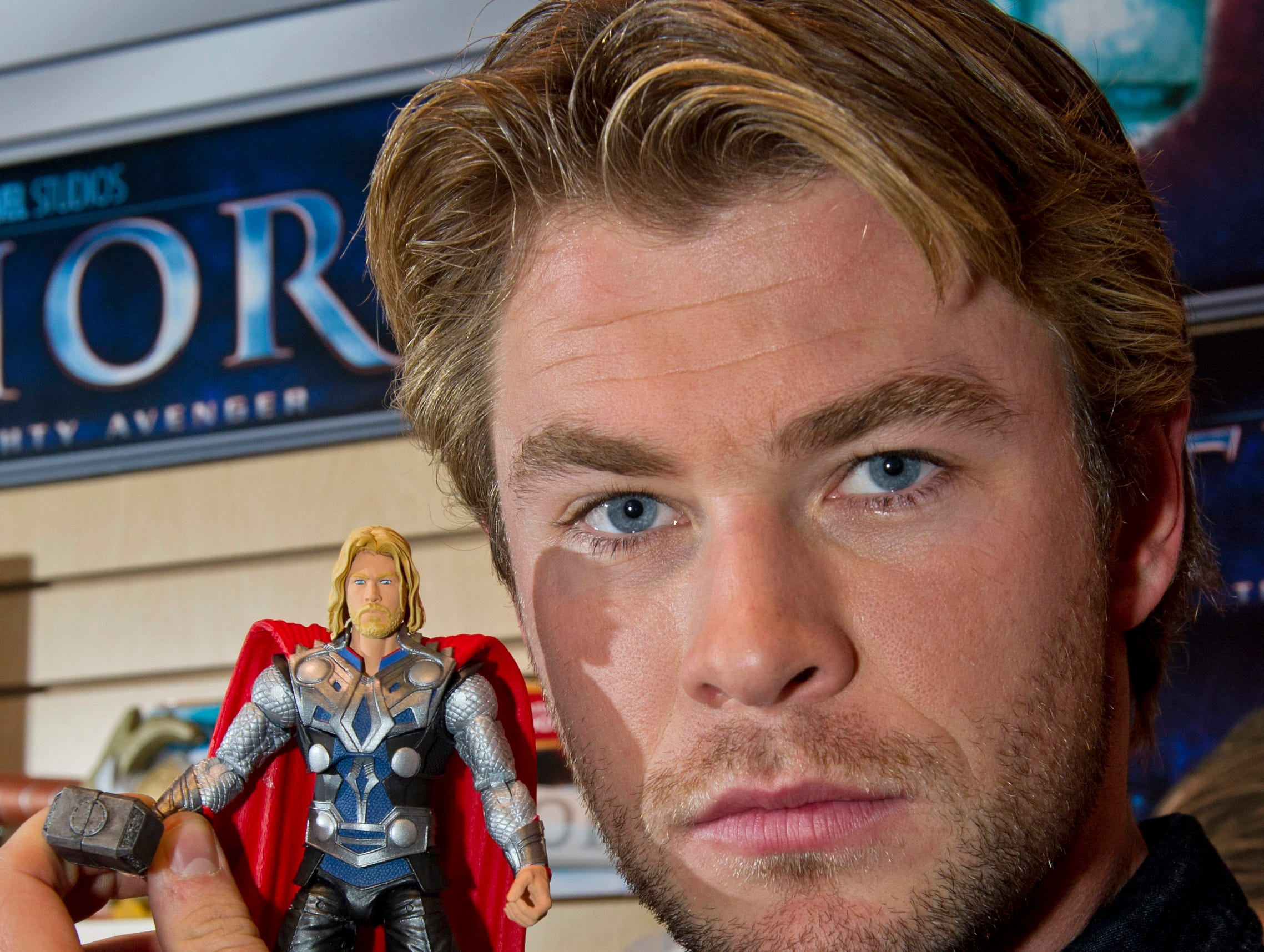 ORG XMIT: NYR108 In this photo provided by Hasbro, Chris Hemsworth, who plays ìThorî in the upcoming film, holds a 6-inch action figure of his likeness, while visiting Hasbro's American International Toy Fair showroom in New York, Tuesday, Feb 15, 2011. (AP Photo/Hasbro, Ray Stubblebine) NO SALES