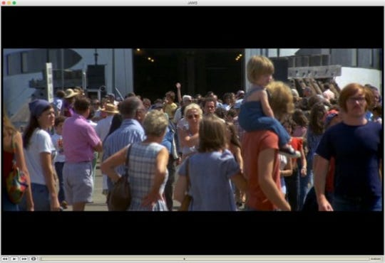 "Crowd scene from ""Jaws."" At left is woman who may be a Cape Cod murder victim known as Lady of the Dunes."