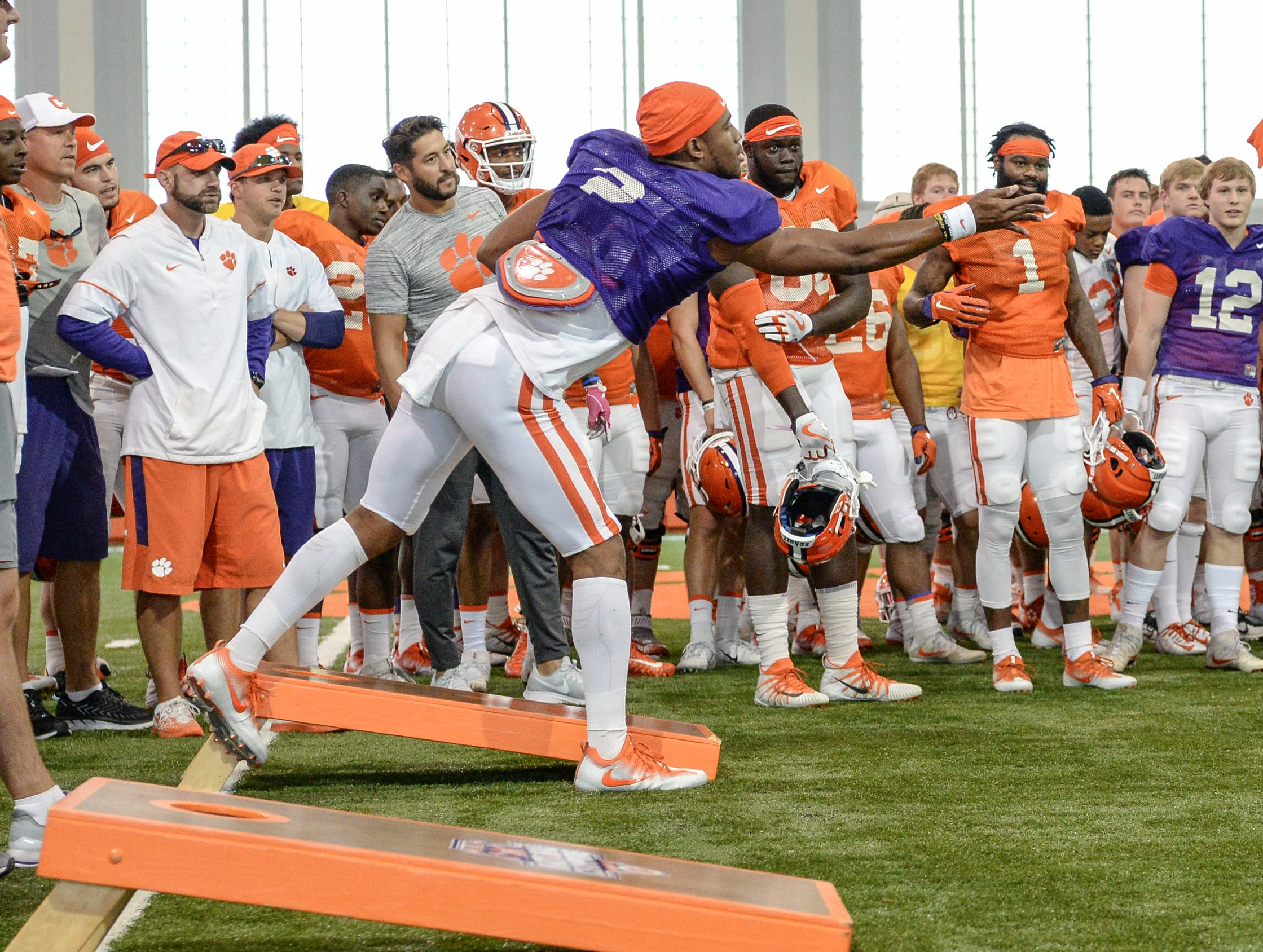 Clemson quarterback Kelly Bryant (2) tosses a beanbag during a corn hole game with Clemson cornerback Trayvon Mullen (1) during fall practice in Clemson on Wednesday.