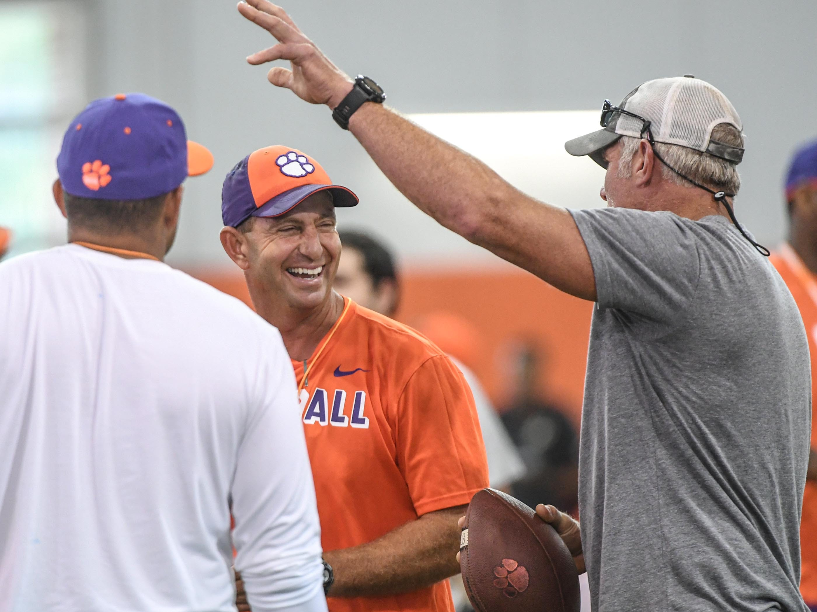 Clemson head coach Dabo Swinney, left, talks with NFL Hall of Fame Class of 2016 quarterback Brett Favre during fall practice in Clemson on Wednesday.