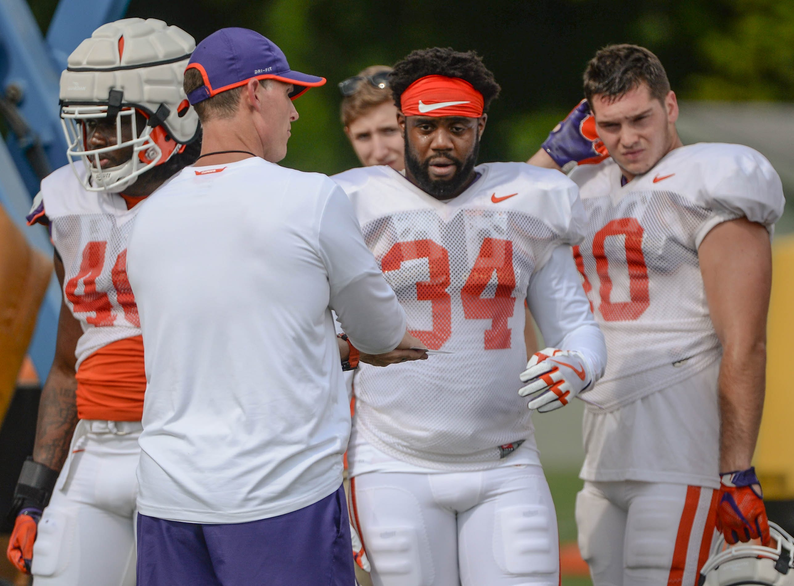 Clemson defensive coordinator Brent Venables talks with linebacker Kendall Joseph (34) and Clemson linebacker Baylon Spector (10) during fall practice in Clemson on Wednesday.