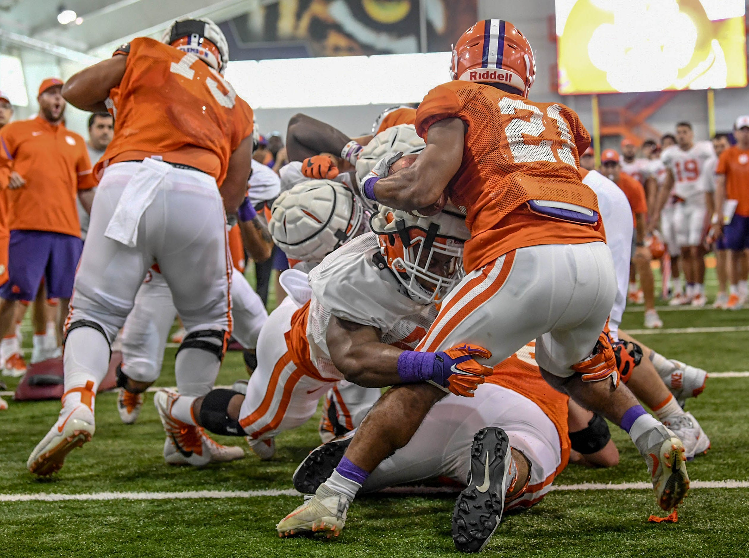 Clemson defensive end Xavier Kelly (22) tackles running back Darien Rencher (21) during fall practice in Clemson on Wednesday.