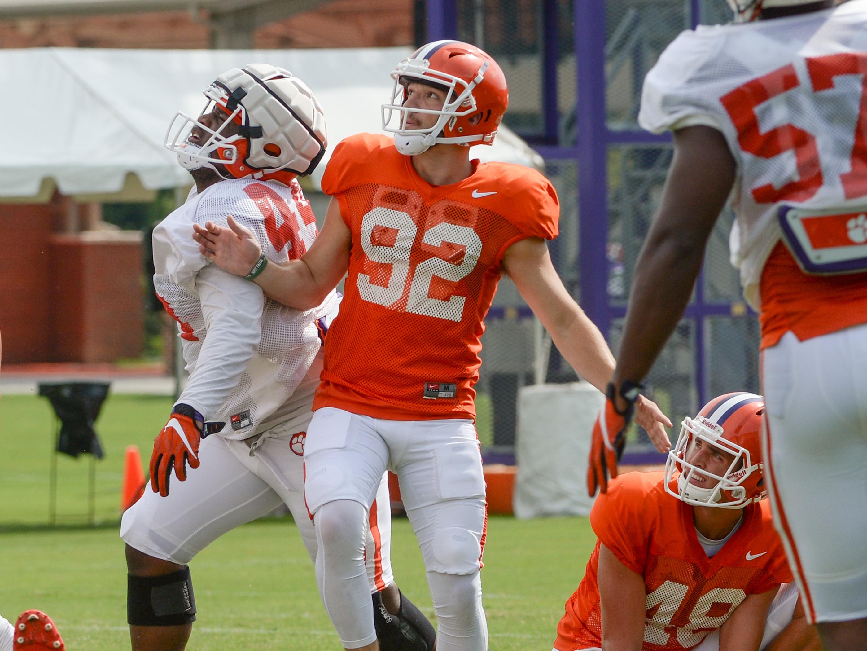 Clemson place kicker Greg Huegel (92) kicks near holder punter Will Spiers (48), right, and defensive tackle Nyles Pinckney (44) during fall practice in Clemson on Wednesday.