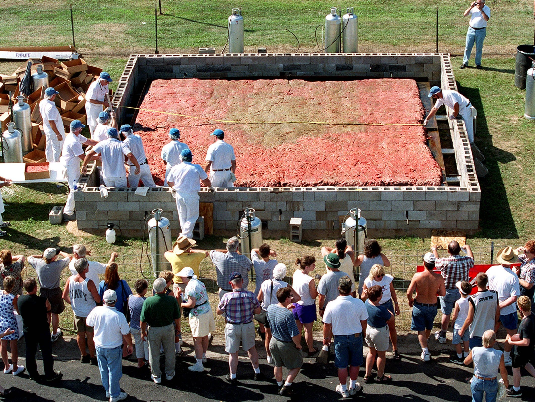 2001: A crowd gathers as volunteers work on a 8,266-pound hamburger Saturday at Burger Fest in Seymour.
