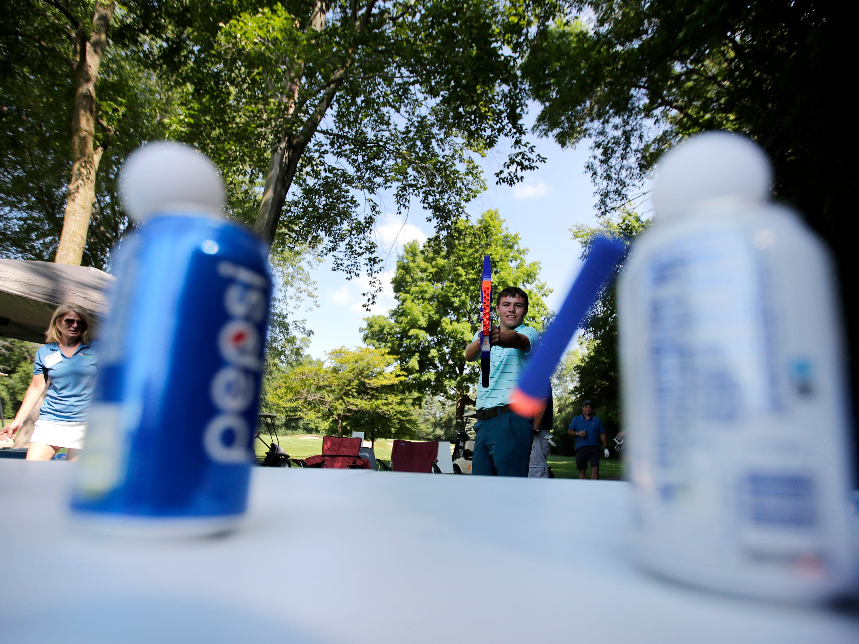 Zach Sheriff, with Fox Valley Auto Auction, plays a game before teeing off during the U.S. Venture Open Wednesday, Aug. 8, 2018, at North Shore Golf Club in Menasha, Wis.