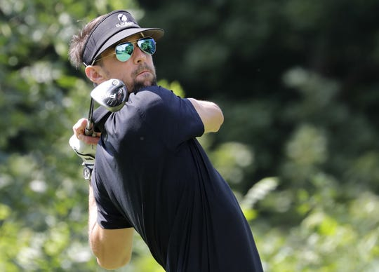 Michael Phelps tees off during the U.S. Venture Open Wednesday at North Shore Golf Club in Menasha.