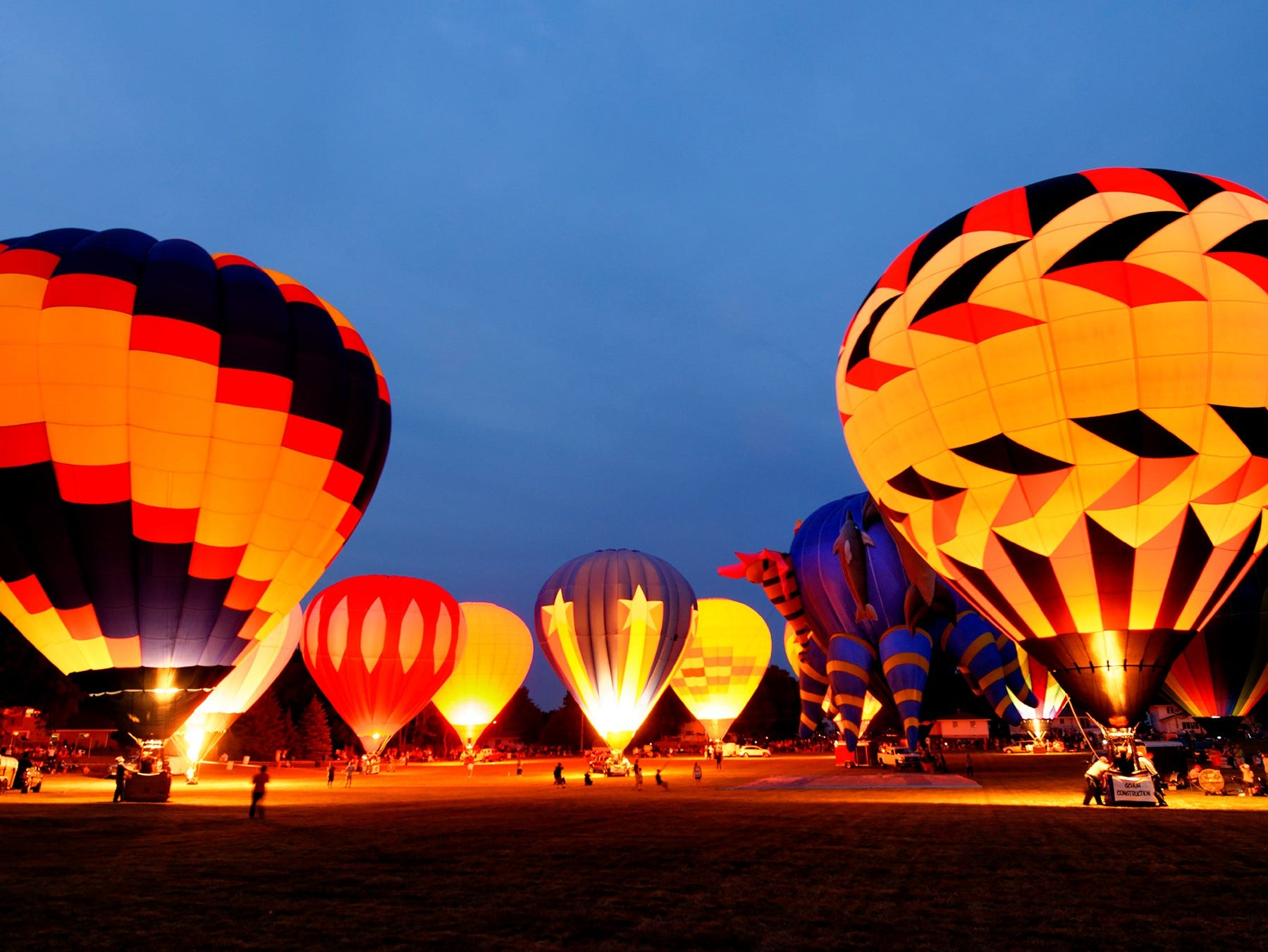 Hot air balloons glow during the Hamburger Fest celebration in Seymour.