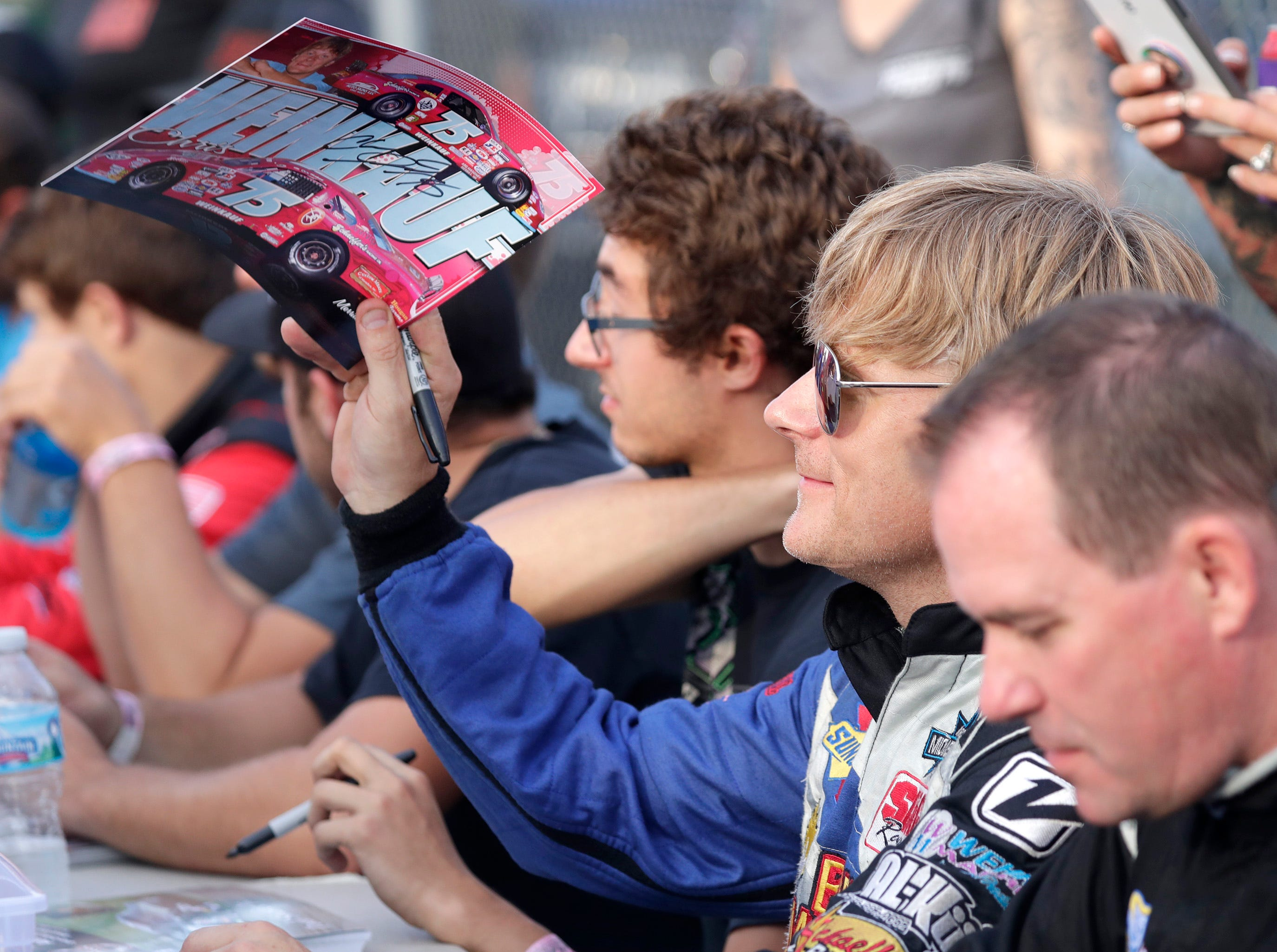 Cghris Weinkauf #75 signs autographs before the ARCA Dixieland 250 on Tuesday, August 7, 2018, at Wisconsin International Raceway in Kaukauna, Wis. 