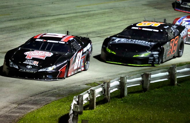Chase Purdy, left, takes a late lead and holds on for the win over Dan Fredrickson during the ARCA Dixieland 250 on Tuesday at Wisconsin International Raceway. Wm. Glasheen/USA TODAY NETWORK-Wisconsin