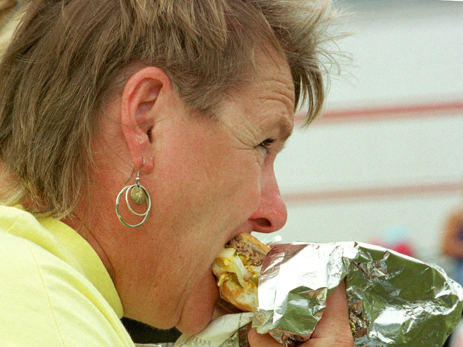 2000: Danne Farrar of Ferndale, Wash., bites into a burger. She traveled to Burger Fest in Seymour on a motorcycle.