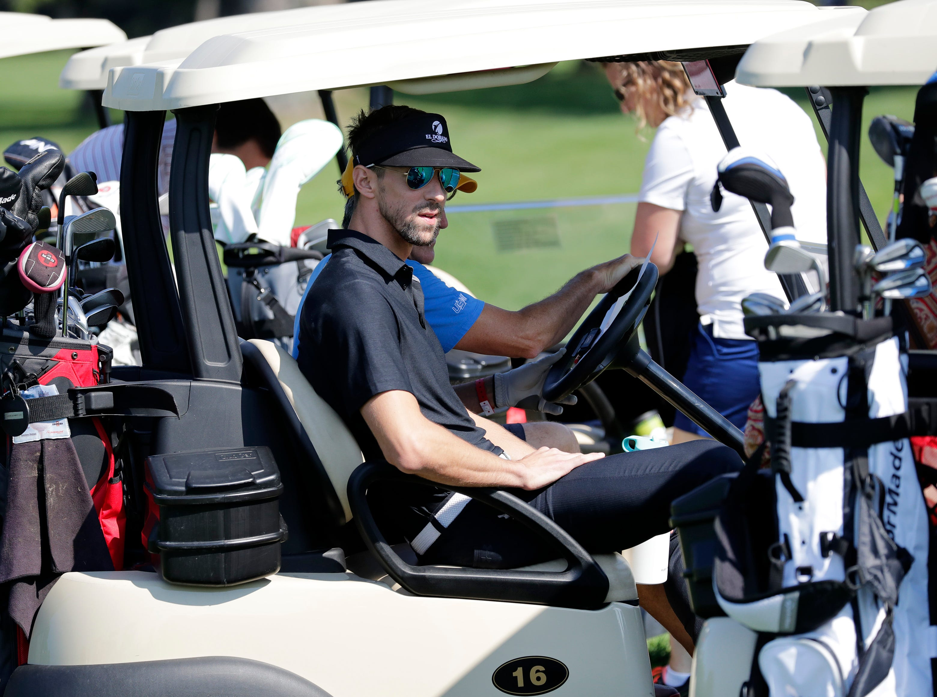 Michael Phelps gets ready to head out onto the course during the U.S. Venture Open Wednesday, Aug. 8, 2018, at North Shore Golf Club in Menasha, Wis.