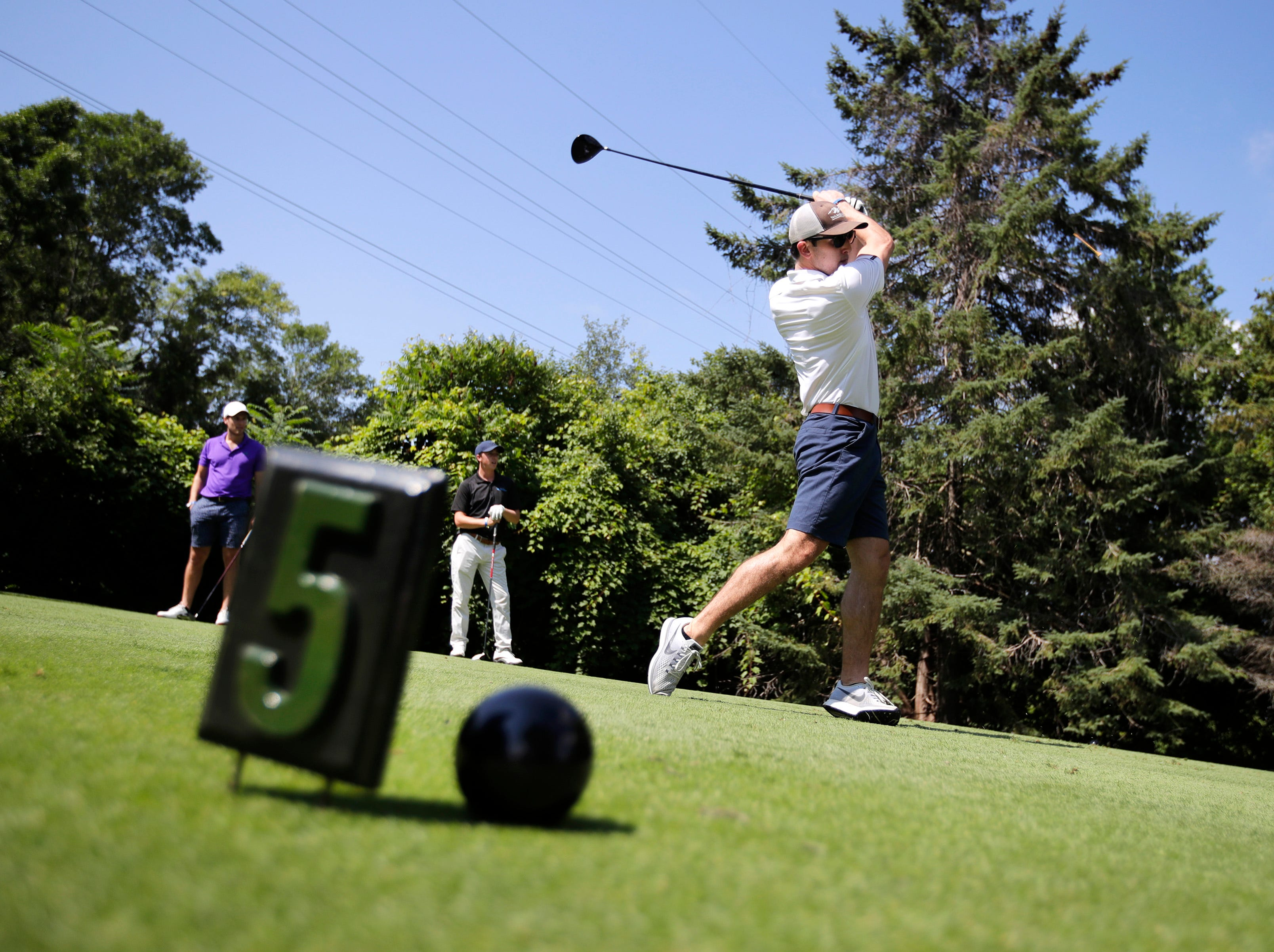 Thomas Schelble tees off during the U.S. Venture Open Wednesday, Aug. 8, 2018, at North Shore Golf Club in Menasha, Wis.