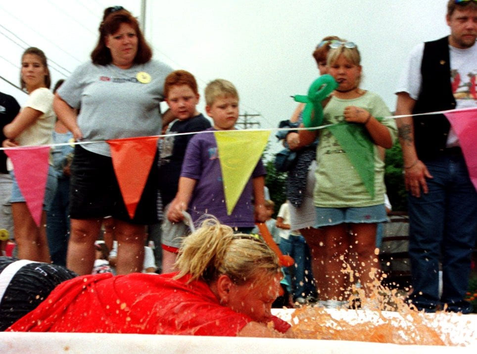 1999: Heidi Cummings of Green Bay slides 57 feet, 3 inches during this run on a 240-foot slide that was covered in ketchup and water during Burger Fest in Seymour.