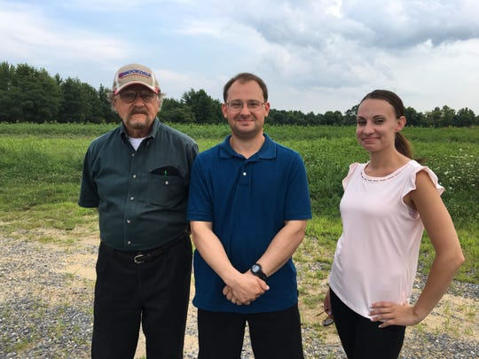 Hazlet residents Bill Shewan, Jon WIlk and Jamie Iacouzzi-Capone standing in front of the Stone Road farm. They are among those leading the charge against the farm's development.