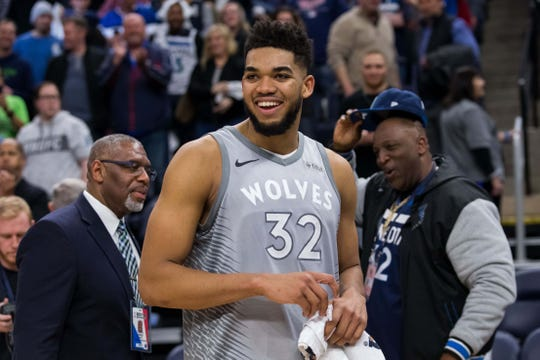 Minnesota Timberwolves center Karl-Anthony Towns (32) celebrates with his dad in the background (right) after the game against Denver Nuggets at Target Center. Mandatory Credit: Brad Rempel-USA TODAY Sports