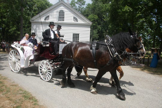 Kevin McMinn of Allentown and Michelle McBride of Robbinsville drive the carriage containing Shaun Pilling of Wall and Laura Howard of Brick away from church toward the reception during the reenactment of the marriage ceremony between Maria Haggerty Allaire  and Thomas Andrews at Allaire Village in this 2010 file photo.