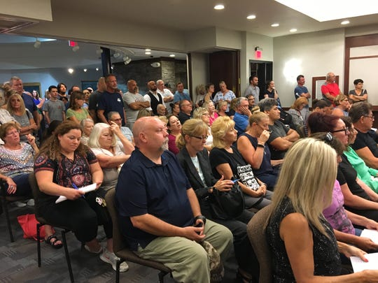An overflow crowd packs Hazlet Township's committee meeting Tuesday.
