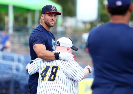 Binghamton's Tim Tebow with Thunder bat boy Tommy Smith as the Trenton Thunder hosted the 2018 Eastern League All-Star Classic at ARM & HAMMER Park in Trenton. July 11, 2018, Trenton, NJ.