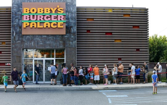 Customers wait on line to meet Chef Bobby Flay during a visit at Bobby's Burger Palace in Monmouth Mall to celebrate the 10th anniversary of the restaurant.  Eatontown,NJ. Wednesday, August 8, 2018 Noah K. Murray-Correspondent Asbury Park Press