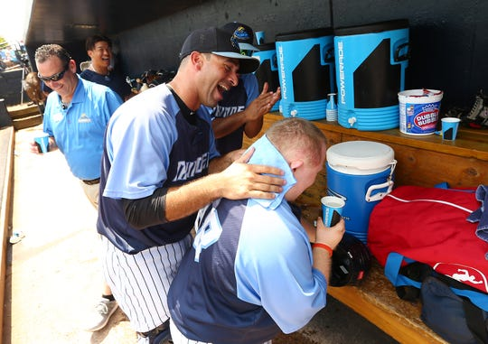 Catcher Jorge Saez lets out a laugh seeing the reaction of third year Thunder bat boy Tommy Smith after he put an ice cold towel on his neck to cool him down at ARM & HAMMER Park Wednesday afternoon against the Altoona Curve. Smith joined up with the Thunder thanks to a connection between his father, Tom, and Thunder General Manager and Chief Operating Officer  Jeff Hurley.  August 8, 2017, Trenton, NJ.