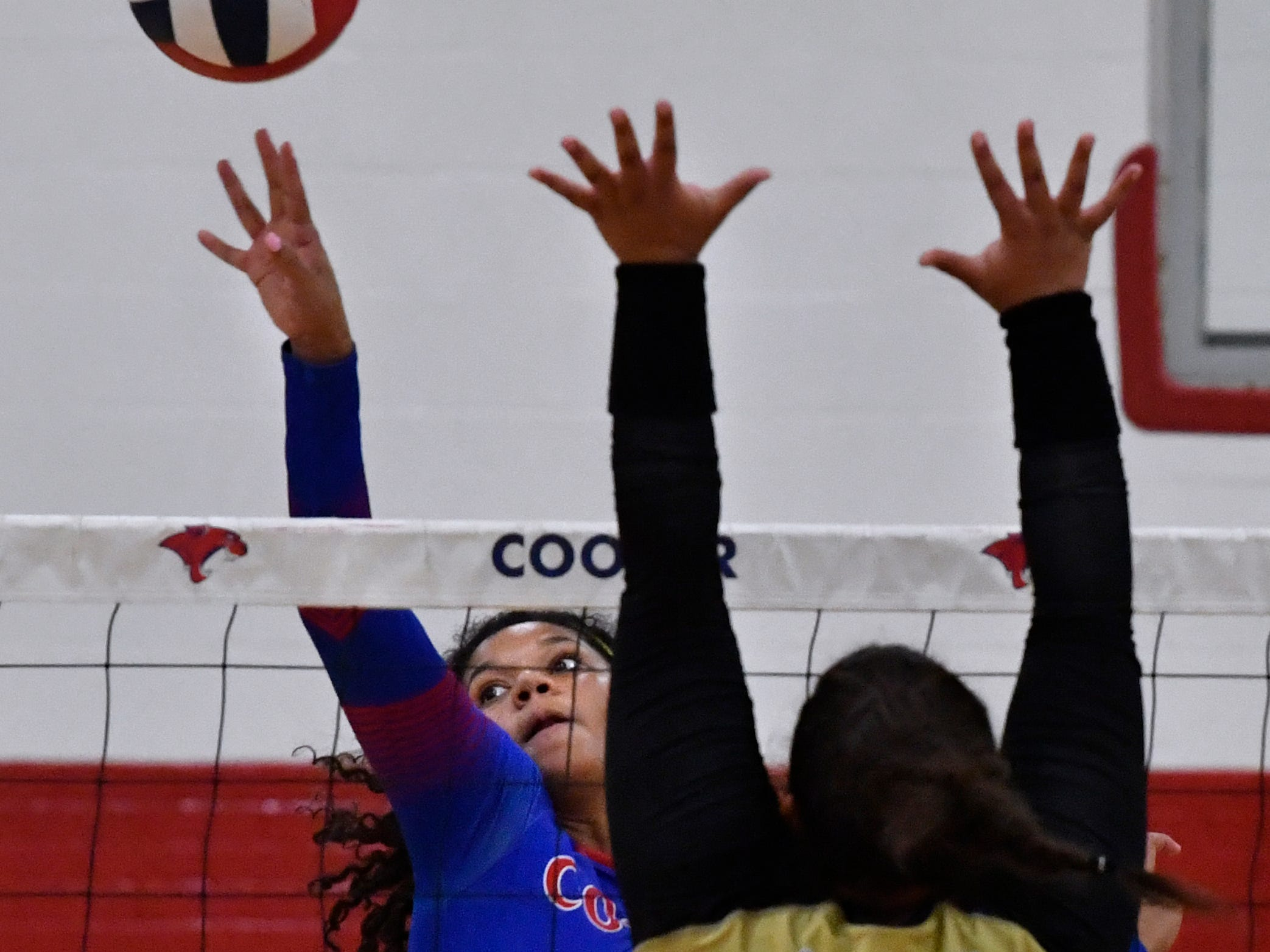 Cooper High's Diamond Brown spikes to ball toward Abilene High's Sydnee Killam. Abilene High won the crosstown volleyball game Tuesday August 7, 2018 against Cooper High in the best-of-five match, 25-21, 16-25, 25-20, 17-25, 15-7.
