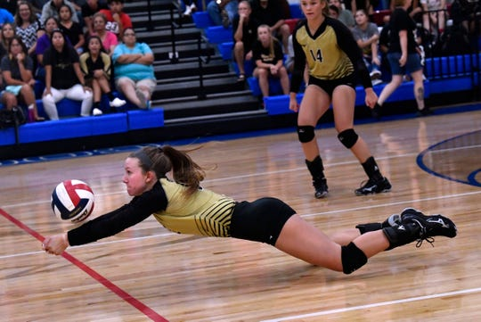 Bailey Proctor makes a successful save for Abilene High against Cooper. Abilene High won the crosstown volleyball game Tuesday August 7, 2018 against Cooper High in the best-of-five match, 25-21, 16-25, 25-20, 17-25, 15-7.