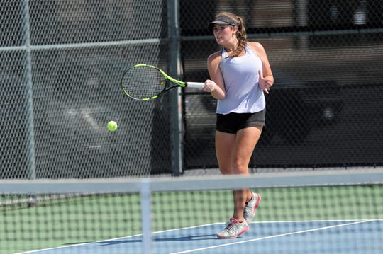 Wylie's Rebecca Yates hits a shot during Tuesday's contest against Midlothian. Yates and Hailey Parker won 6-0, 6-1 at No. 3 girls doubles.
