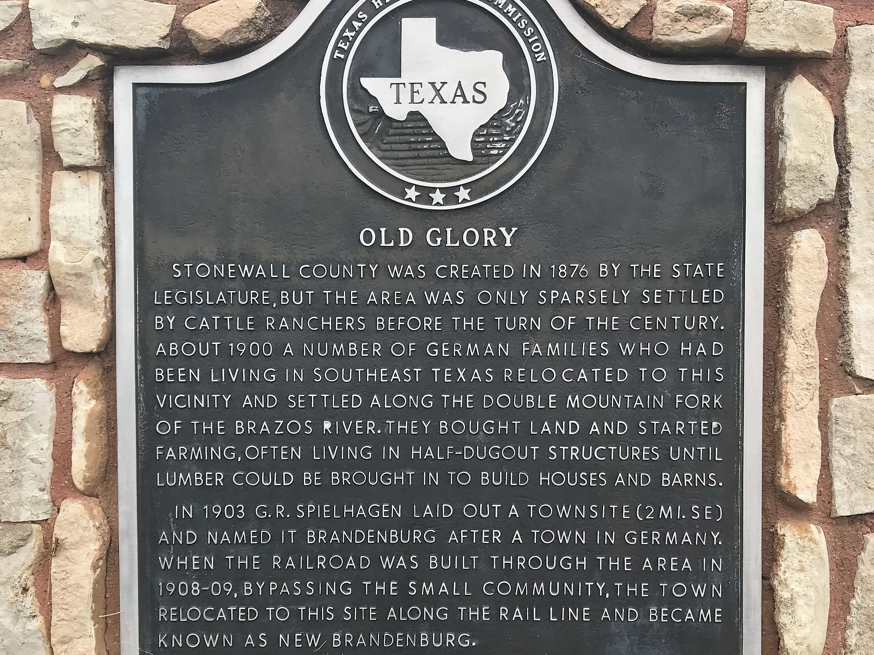 The historical marker in Old Glory.