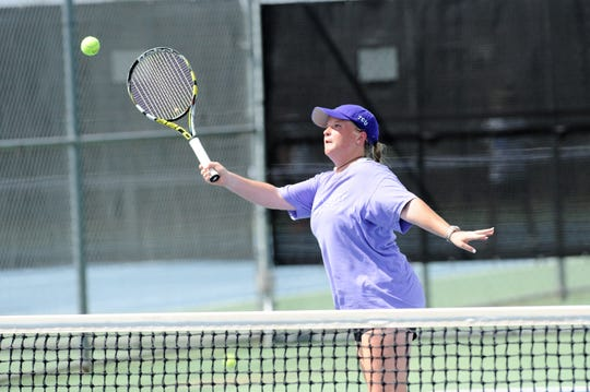 Wylie's Elle Schroeder hits a shot at the net during Tuesday's match against Midlothian. Schroeder and partner Madison Andrews won 6-0, 6-0 at No. 2 girls doubles.