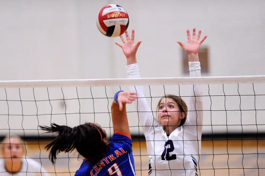 Wylie's Madison Burden (12) reaches for a block during the team's home opener Wednesday.