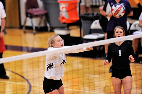 Wylie's Lexie Miller (11) pushes the ball over the net during a march against San Angelo Central earlier this year.