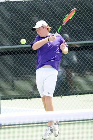Wylie's Cole Edwards follows through on a shot during Tuesday's match against Midlothian. Edwards and Aric Richardson won 6-0, 6-3 at No. 2 boys doubles.