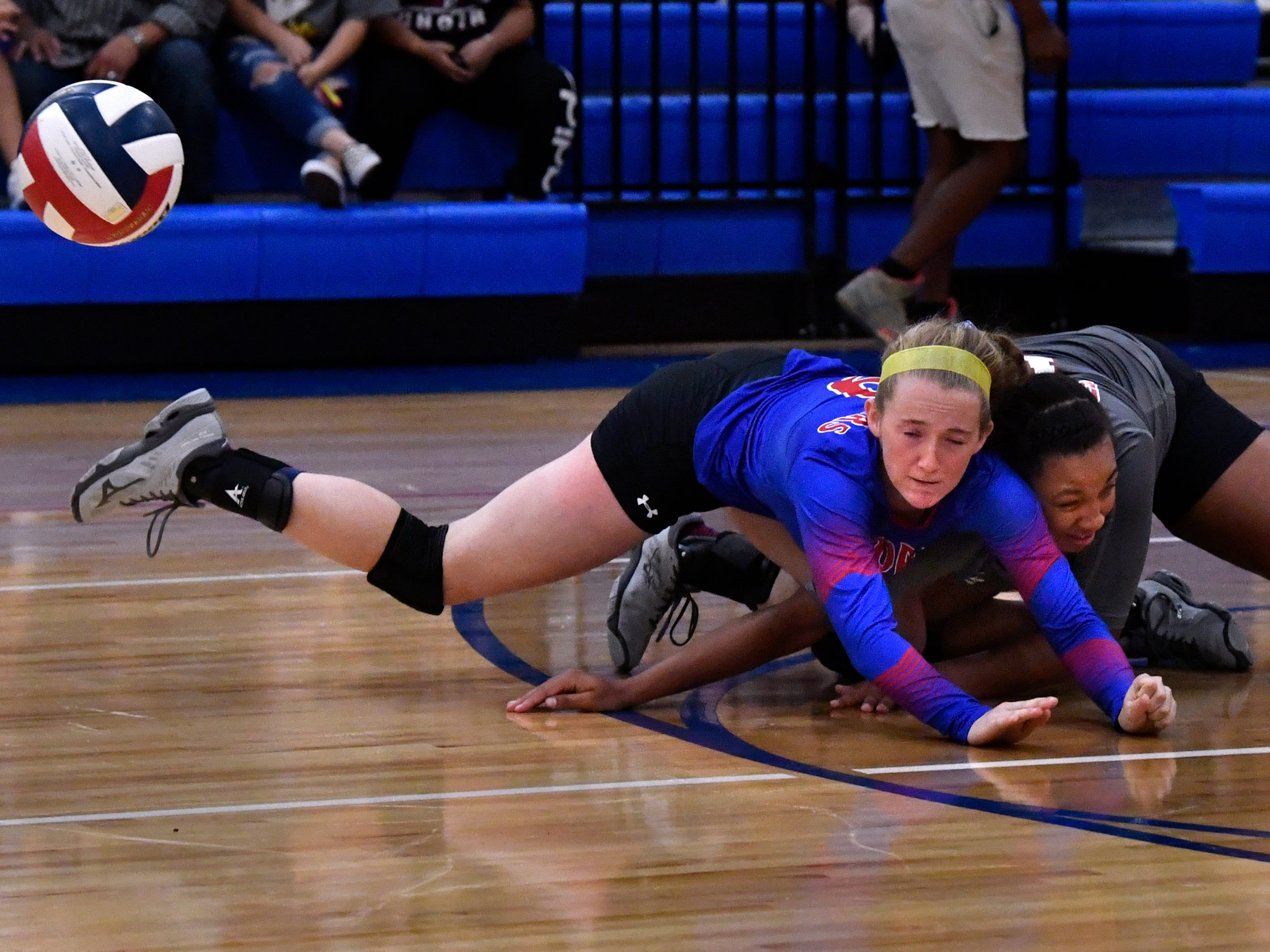 Cooper High's Caylee Collier collides with teammate Jennika Willis as they both dive for the ball. The girls appeared to be uninjured and continued to play. Abilene High won the crosstown volleyball game Tuesday August 7, 2018 against Cooper High in the best-of-five match, 25-21, 16-25, 25-20, 17-25, 15-7.