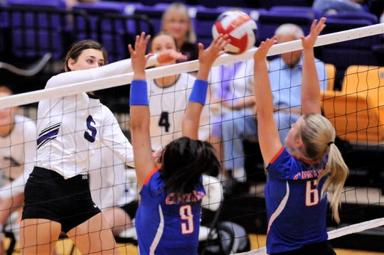 Wylie's Lilly Kate Doby (5) hits the ball between a pair of San Angelo Central defenders during the team's home opener Wednesday.