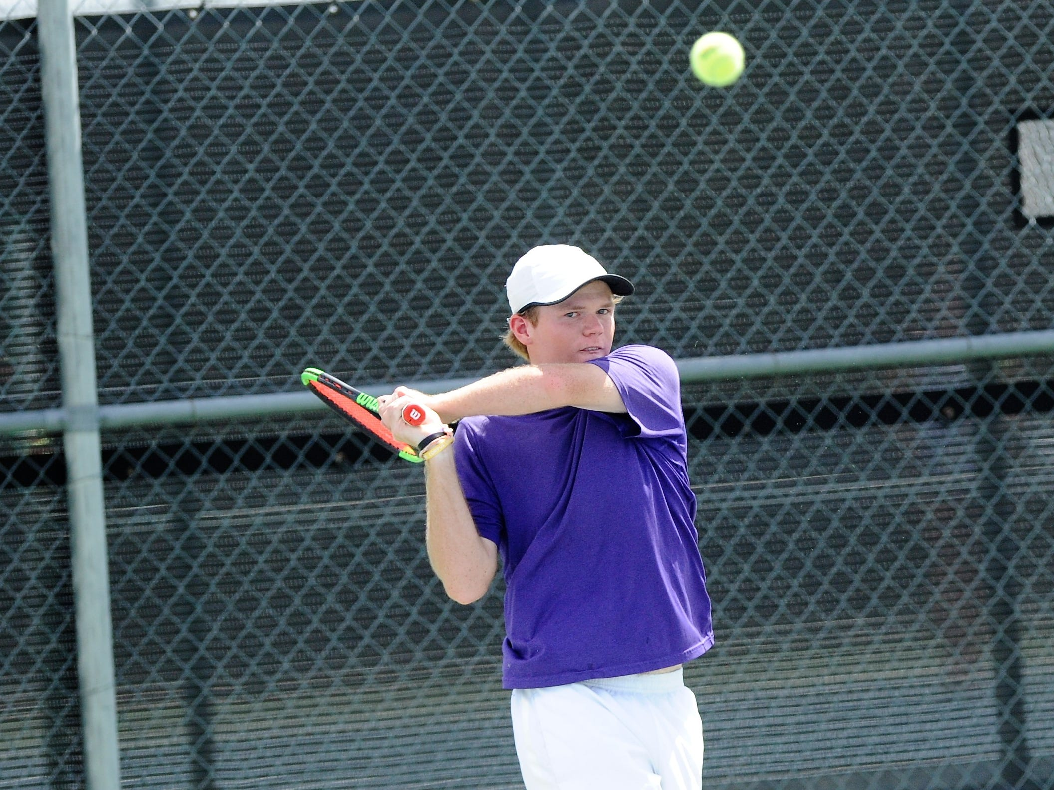 Wylie's Cole Edwards watches his backhand shot during Tuesday's match against Midlothian. Edwards and partner Aric Richardson won 6-0, 6-3 at No. 2 boys doubles.
