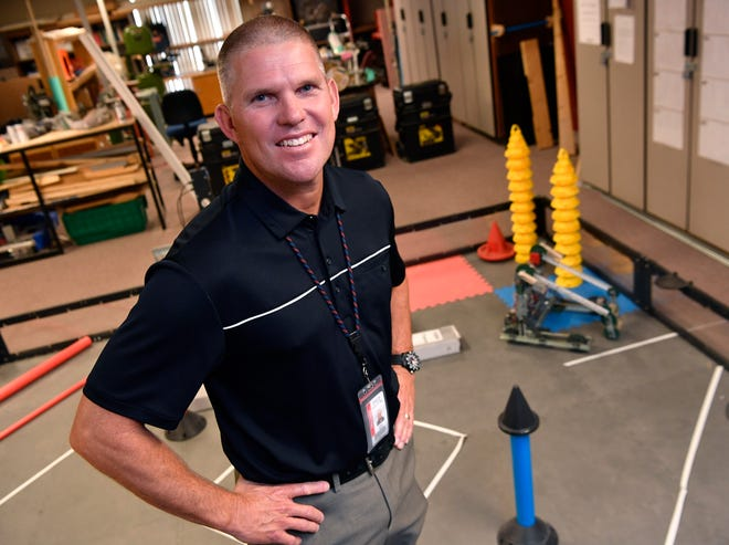 Jeff Howle, the new principal for ATEMS, in the school's robotics lab.