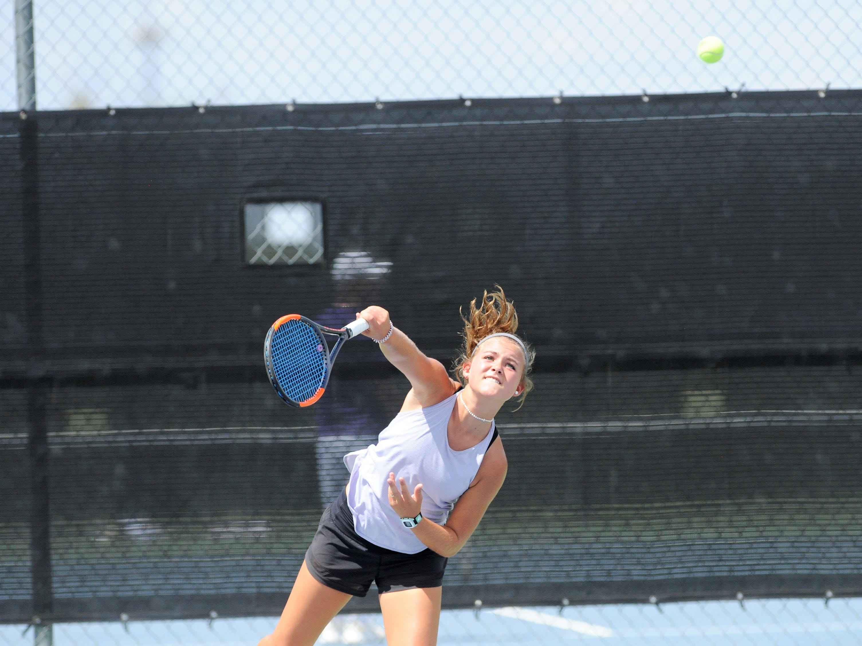 Wylie's Leighton Alford serves during Tuesday's match against Midlothian. Alford and girls doubles partner Analeah Elias won their match 6-0, 6-0 at No. 1 girls doubles.