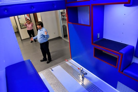 Andy Weaver is framed in the doorway of an ambulance simulator at Texas State Technical College's new Abilene campus.