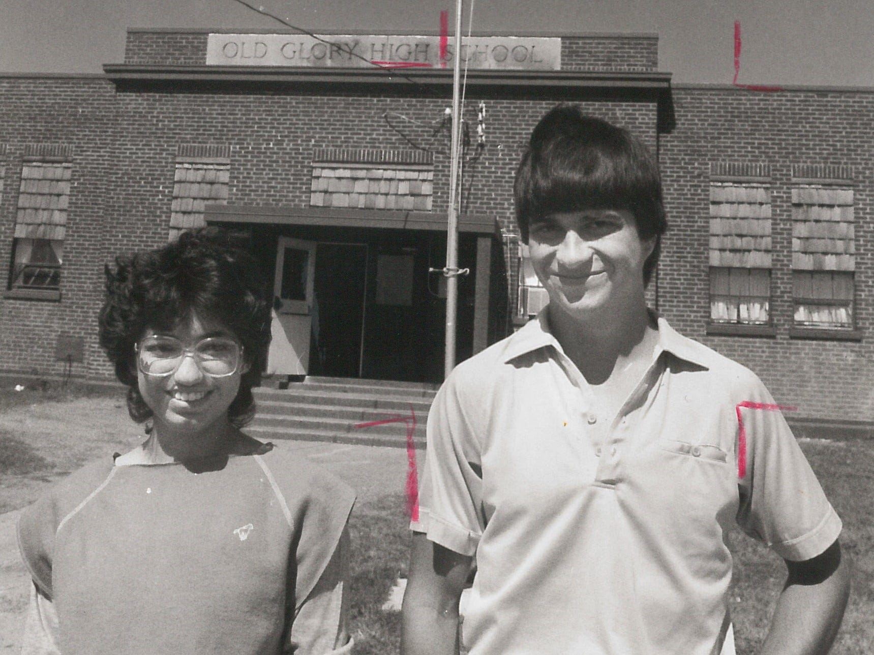 Maribel Castro and Bobby Lowack stand in front of Old Glory High in 1985.