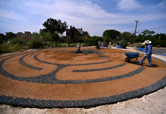 Workmen constructed a labyrinth in the First Central Presbyterian Church meditation garden in August 2018. The center was to feature a limestone fountain when completed.
