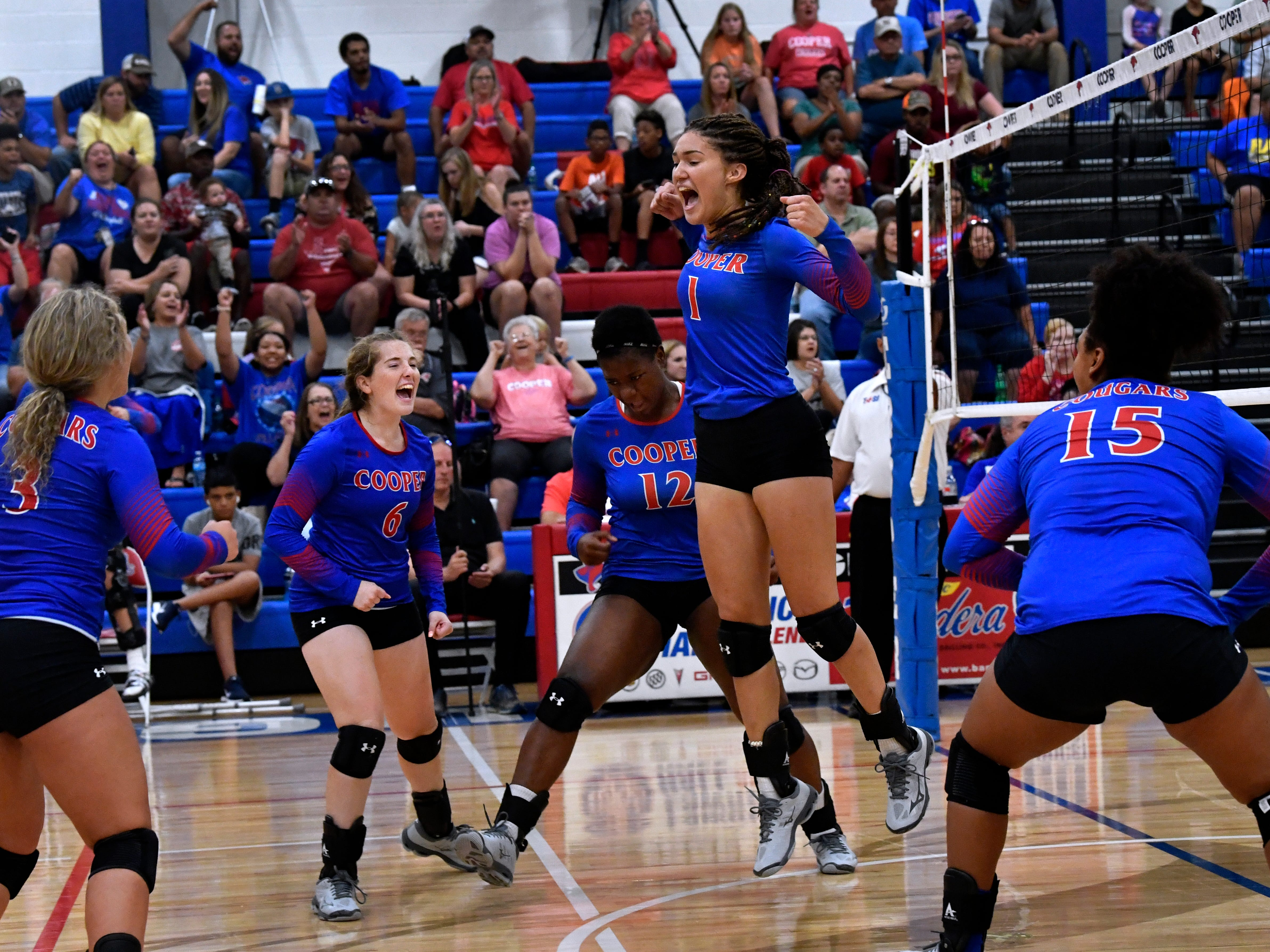 Cooper High School players celebrate a play against the Lady Eagles. Abilene High won the crosstown volleyball game Tuesday August 7, 2018 against Cooper High in the best-of-five match, 25-21, 16-25, 25-20, 17-25, 15-7.