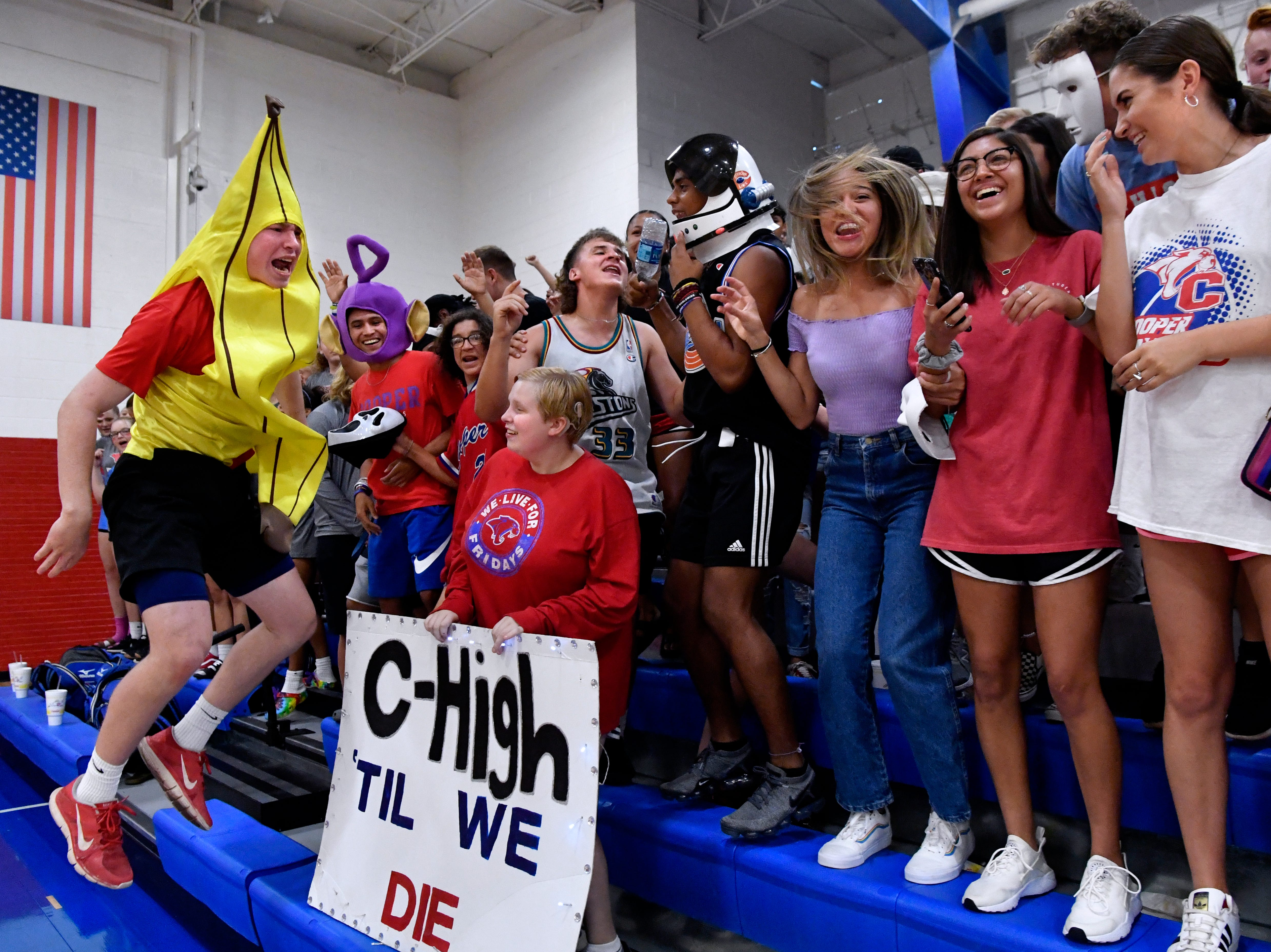 Brady Miller, an incoming Cooper High School sophomore, cheers the Lady Coogs Tuesday August 7, 2018 with his classmates while wearing a borrowed banana costume. Abilene High won the crosstown volleyball game against Cooper in the best-of-five match, 25-21, 16-25, 25-20, 17-25, 15-7.